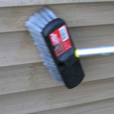 Cleaning siding with brush